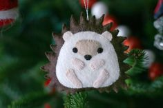 Sasha the Hedgehog. Not a Carolyn DeAngelis ornament, but I kept the same style.