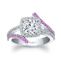 This unique, pink sapphire and diamond halo engagement ring features a prong set cushion cut diamond center, with a diamond halo encircling it.  The split shank that rises to the center halo is adorned with shared prong pink sapphire and diamonds for added drama. <br />  <br />  Also available in rose, yellow gold, 18k and Platinum.