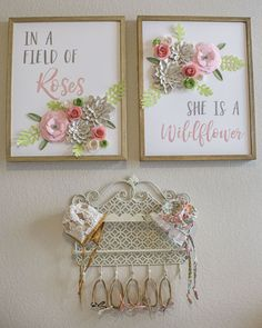 Posters from hobby lobby...possibly spray paint frame silver and add pink paper flowers