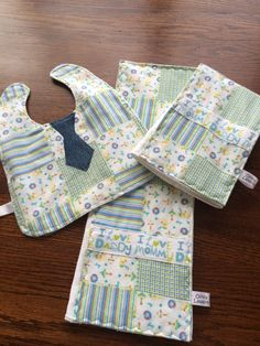 SOLD. Two burp cloths and bib ensemble in soft flannel patch work design with denim tie. See more adorable designs at OliviaLawsonDesigns.etsy.com
