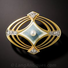 Diamond and Pearl Enamel Brooch. By Bipart, Griscom & Osborn of Newark, New Jersey, circa 1900, a darling and distinctive pin designed with striking concentric ovals, rendered in velvety 14K yellow gold, framing a pearl-set, baby blue guilloche enamel center with small diamond sparklers gracing the cardinal points.