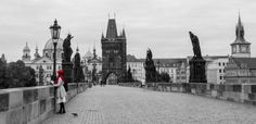 Charles bridge early morning. This lady walked the bridge and it was a perfect picture moment