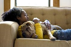 Young woman and her Shar-Pei napping on a couch - fStop Images - Winnie Au/Getty Images