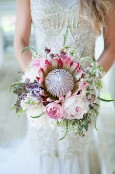 This wedding bouquet is to die for💓😱 —————————————————————— Repost from using - We are HERE for the proteas! Who else is loving this unique bouquet trend? Bouquet De Protea, Lilac Bouquet, Purple Wedding Bouquets, Lilac Wedding, Bride Bouquets, Bridal Flowers, Ideas