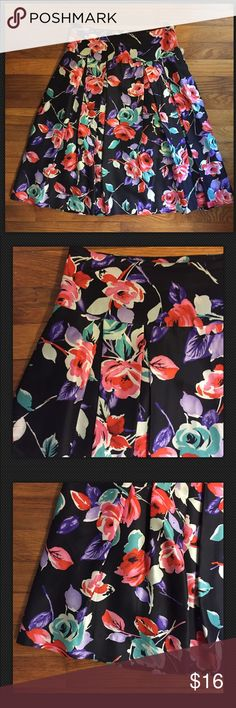 """Express MultiColor Floral Print Silk Pleated Skirt Express Design Studio Women's Sz 6 Multi-Color Floral Print Silk Skirt Pleated • size 6 • Excellent pre-loved condition • 14.5"""" waist  • 26"""" length • Side zipper with hook and eye closure • on seam pockets • pleating • Shell 100% silk • Lining 100% polyester Express Skirts"""