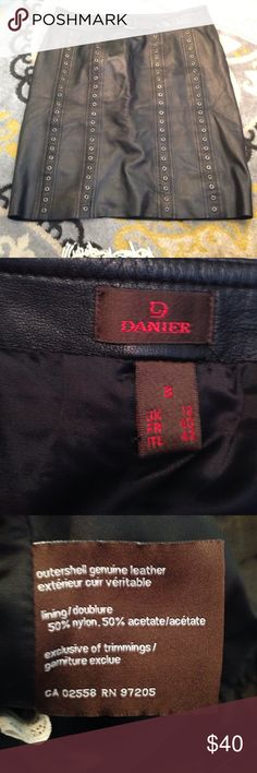 Funky real leather skirt Danier of Canada. Waist 32 with side zipper. Softest most beautiful leather. Small tears in seam of lining on seams in sides. Makes no difference what so ever for wear. No flaws, damage or smells. 21 inches long. Really excellent, feels like butter to wear this skirt. Danier Skirts