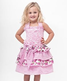 There's nothing bashful about this ruffled dress. From its big bow accent to its stylish cut, this sweet piece is begging to play a starring role in any active girl's wardrobe.100% cottonMachine wash; tumble dryImported