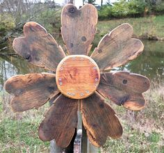 This is my favorite barn wood wreath I've made so far. Handcrafted from reclaimed barn wood & metal: hang this natural wood accent in a cabin great room or on a garden gate! SouvenirFarm $100.00