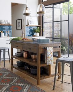 Like a treasured vintage find or a custom-designed piece, this elegant kitchen island serves as a rustic yet refined workstation for the home cook or entertaining enthusiast. Bluestone is crafted with reclaimed pine from old buildings and doors and a lustrous slab of bluestone