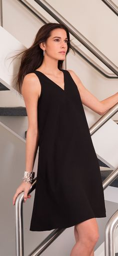 Lauren Ralph Lauren Must-Have Dresses: An alluring V-neckline at the front and the back makes this black crepe shift dress ideal for date night or dinner with friends. Wear it with knee-high boots for transitional seasons.