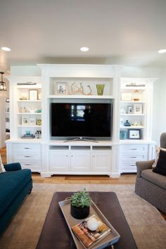 * I really like this!! ----------------------- I think I like this because of the varying height, and the open shelves are full, but not with overly bold stuff. Doesn't make it compete with TV for your eyes