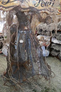 "wire and scrap metal ""Alice"" by Magnolia pearl...  This was at the Antque show in Texas....Cool Art Work"
