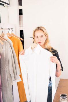 Georgia Lazzaro Talks Protagonist Spring 2017 and More: Clothing rack with yellow accents and a white button down shirt   coveteur.com