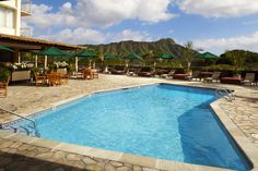 Relax on Queen Kapiolani's Sundeck & enjoy the poolside bar & stunning Diamond Head views #Hawaii #Waikiki #AquaHotels