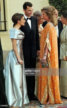 Queen Noor of Jordan greets Spanish Crown Prince Felipe and fiancee Letizia Ortiz Rocasolano as they attend a gala dinner at El Pardo Royal Palace May 21, 2004 in Madrid. Spanish Crown Prince Felipe de Bourbon and his fiancee, former journalist Letizia Ortiz are to wed in Madrid on Saturday, in the first royal marriage in Spain of a crown prince or a king in nearly a century.