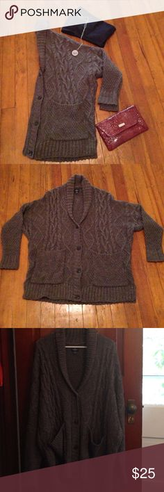American Eagle gray cardigan plus size xxl American Eagle gray cardigan plus size xxl. Two pockets in the front four buttons down the front acrylic, polyester, wool blend. Great condition American Eagle Outfitters Sweaters Cardigans
