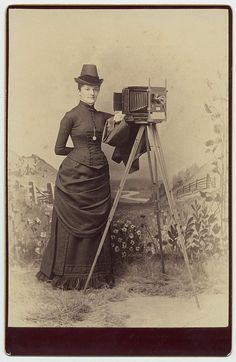 An elegantly dressed unidentified female photographer from the 1880s.