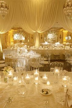 Candles on tables and endless lucite chairs. So romantic | @dominiquefierro | Brides.com