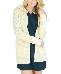 Indulge in the perfect combination of comfort and fashion-savvy style. This layer-ready cardigan showcases a vintage-inspired pointelle knit and handy hood for optimal coziness.