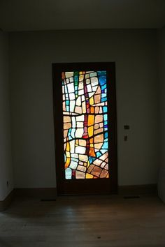 """This door panel is made using 1"""" thick Dalle-de-verre glass and epoxy. It is fabricated and installed in three sections.   36""""w  x 84""""h   220 lbs     2011"""