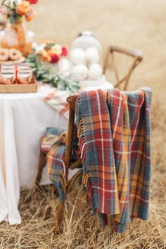 warm and cozy plaid throw blanket draped on chairs at this Fall party  Photography : Torrey Fox  Read More on SMP: http://www.stylemepretty.com/living/2016/11/01/how-to-celebrate-fall-with-your-best-girlfriends/