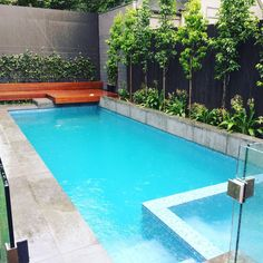 Pool spa combo/ water feature/bisazza glass tile/stepping stone/built out of ground courtyard pool with beadcrete finish/infloor cleaning/enviroswim sanitation 20 Meter fully tiled Lap pool with in…