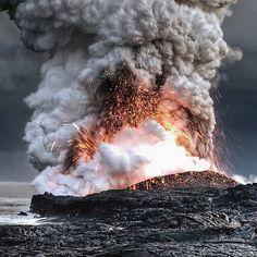 Lava flowing into ocean, Hawaii. Photo by © Alain Barbezat