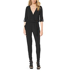 When a stylish opportunity presents itself, jump right in. Our roll-sleeve jumpsuit is an easy way to look instantly chic, polished and playful. With a cross front and tapered cuff, the relaxed silhouette drapes for a flattering fit that works for day and night. We added studs at the shoulders for a touch of tough-girl style. Team it with the season's studded heels for an edgy look from head-to-toe.