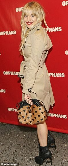 Sienna Miller arrived at the premiere of Orphans wearing a knee length trench coat and high heeled leather boots