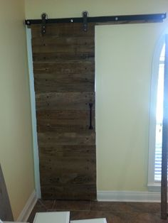 Barn door for pantry made with reclaimed cypress.