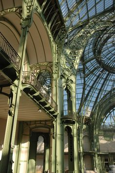 Le Grand Palais - Paris - 1900 Le Grand Palais Crowned by an expansive, barrel-vaulted, cast iron and glass ceiling, the Grand Palais is itself an attraction. Constructed for the Universal Exposition of 1900, it contains multiple galleries that play frequent host to blockbuster traveling exhibitions. #travelcompanion