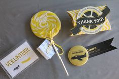 """2013 NPHW Film Festival (small items): volunteer tag, lollipop thank you gift for volunteers, """"thank you"""" pillow box containing a yellow flashdrive for our speakers, and finally, magnetic button/committee nametag"""