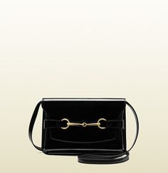 black patent leather shoulder bag with horsebit detail