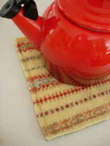 Use old wool sweaters for trivets or potholders.