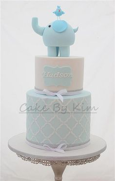In love with this soft, pastel blue + white elephant baby shower cake.