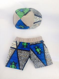 Here is a unique African wax cotton print baby boy's green and blue shorts and matching cap set. Perfect for sunny days. African Wear, African Style, African Fashion, African Fabric, Baby Prints, Blue Shorts, Sunny Days, Baby Items, Wax