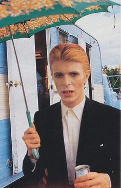 David Bowie with an umbrella... What more could you want?