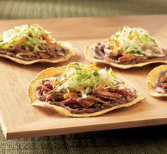 Spice it up! These Shredded Pork Tostadas are easy, quick, and perfect for a weeknight dinner.