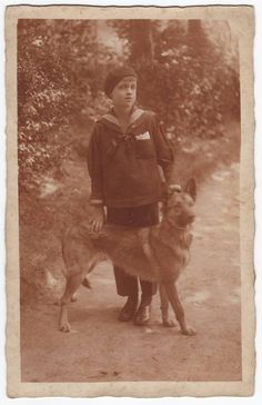 A boy and his dog Antique belgian sepia photo postcard by Isimaya