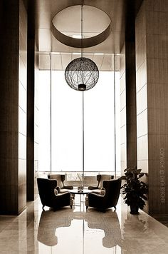 Form, Shape and Mass, this space has a large form defined by the circular shape of the light fixture that has a mass that fits the space.