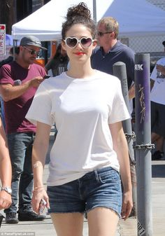 Nice shades: Emmy Rossum wore white, heart-shaped sunglasses on Thursday while on the set of Comet filming in Los Angeles
