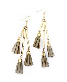 A gorgeous blend of textures make this the ideal accessory for the boho-chic. With tassels of faux-leather dangling in a most delicate, yet carefree, manner, the pair is contrasted by a very feminine, metallic elements in gold. These boho-chic earrings will definitely not remain hidden, but neither will a personality a Tassel Earing, Tassel Necklace, Boho Chic, Tassels, Dangles, Delicate, Feminine, Drop Earrings, Personality