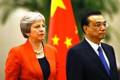 British Prime Minister Theresa May vowed she would address human rights concerns in Hong Kong during her visit to China.