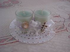 Hand poured container candles in sea-green, decorated with Translucent lavender and white ribbons, pearls and sea shells
