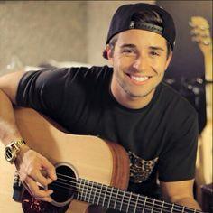 Jake playing his guitar