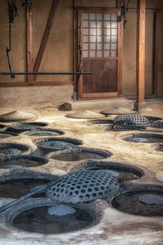 Indigo dyeing vats at the Yoshio Mori workshop in Kyoto, Japan; Mori-san is a generation dyer whose family has been living and working on this same property for 140 years