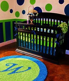 So much fun- #green and #blue polka dots with a custom rug!  #customrug #polkadots #nursery