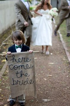 Exactly what I want at our vow renewal except I want the sign to say here comes the bride (again)