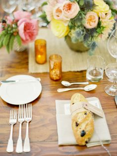 mini baguette wrapped with brown paper, bakers twine and place card...