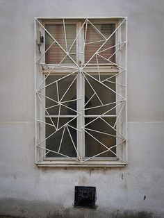 Vernacular Modernism // goenetix [Flickr]. Liking this security-orientated, aesthetic of this window design